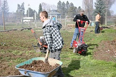 JASON CHANEY - Heart of Oregon students work to prepare the Prineville Community Garden for the upcoming growing season. The Seed to Supper program will teach Redemption House women how to grow vegetables in the garden beginning this spring.