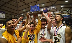 VERN UYETAKE - Jaydon Grant, Brooks DeBisschop, Ben Baldwin, Ryan Kelley and Anthony Mathis hoist the trophy and celebrate their most recent state championship win over Jesuit.
