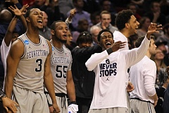 COURTESY OF DAVID BLAIR - Georgetown University players whoop it up as the Hoyas pull away from Eastern Washington.