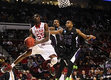 COURTESY OF DAVID BLAIR - Utah's Delon Wright looks to pass around his Stephen F. Austin defenders. The Utes advanced Thursday with a victory at Moda Center. They'll play Georgetown here on Saturday, with Arizona meeting Ohio State in the other third-round game of the Portland regional.