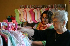 JASON CHANEY - Prineville's Pregnancy Resource Center Director Anna Tracy (LEFT) and volunteer Sharon Grant look over clothing in the center's baby boutique.