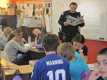CONTRIBUTED PHOTO - Officer Jeff Coffman conducts a DARE course at Crooked River Elementary School earlier this year.