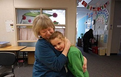 BARBARA SHERMAN - Barbara Gorick hugs her granddaughter, Alina Mohr, outside the first-grader's classroom at Deer Creek Elementary in King City.