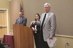 INDEPENDENT PHOTO: TYLER FRANCKE - Marion County Commissioner Kevin Cameron, right, speaks during the local chamber's 'state of the county' event at Woodburn Health Center last week, while commissioners Sam Brentano and Janet Carlson look on.