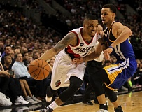 COURTESY OF DAVID BLAIR - Trail Blazers guard Damian Lillard drives on Golden State's Stephon Curry.