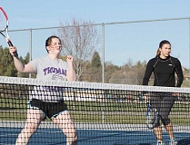 JEFF WILSON/THE PIONEER - Jenni Young, left, and Sophie Gemelas are back on the tennis court as doubles partners this year. They took last year off to pursue other interests.