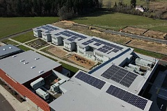 SUBMITTED PHOTO - Soon more Beaverton schools will have solar arrays on their rooftops. This aerial view of Springville K-8 School shows a 2011 project with a private investor, but new schools will generate electricity with funding from a voter-approved bond measure.