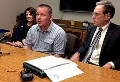 TRIBUNE PHOTO: PETER WONG - Ted Bradford, center, talks about how DNA testing led to his eventual acquittal on a rape charge in Washington state, but only after he served a 10-year prison sentence. Flanking him at a Wednesday appearance at the Capitol were Aliza Kaplan, associate professor at Lewis & Clark law school, and Steven Wax, legal director of the Oregon Innocence Project and former federal public defender for Oregon.
