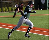 DAN BROOD - TURNING THE CORNER -- Tigard High School sophomore Connor Wojahn looks to round first base and head toward second as he doubled in the fifth inning of the Tigers' 8-2 victory over North Marion.