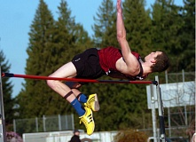 DAN BROOD - SO CLOSE -- Sherwood senior Ben Milligan nearly get over the bar, set here at 7-0, during last week's meet.