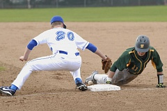 PARKER LEE - West Linn shortstop Tim Tawa slides in safely during a preseason game against Gresham.