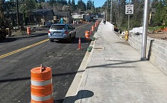 SUBMITTED PHOTO - New sidewalk crosses the reopened section of Southwest Oleson Road. Construction work will continue at the site for another two months.