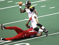 TRIBUNE PHOTO: JAIME VALDEZ - Portland Thunder nose guard Marquis Jackson gets hold of L.A. KISS quarterback Adrian McPherson, forcing an incomplete pass during Friday night's 42-37 Thunder win at Moda Center.