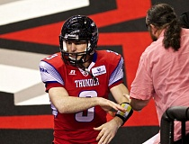 TRIBUNE PHOTO: JAIME VALDEZ - Portland Thunder quarterback Kyle Rowley accepts congratulations from a fan after the home team's 42-37 victory over the Los Angeles KISS in their Arena Football League season opener Friday night at Moda Center.