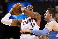 TRIBUNE PHOTO: JAIME VALDEZ - LaMarcus Aldridge (left) led Portland past Denver on Saturday with 32 points and 11 rebounds.
