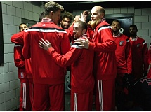 The Trail Blazers gather outside their locker room moments before Saturday night's home game against Denver.+