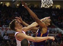 TRIBUNE PHOTO: JAIME VALDEZ - Trail Blazers center Meyers Leonard (left) contests a shot by Phoenix Suns forward T.J. Warren during Monday night's victory by Portland at Moda Center.