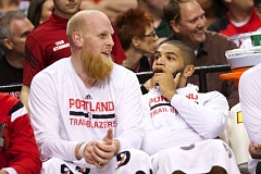 Chris Kaman (left) and Nicolas Batum have time to share stories on the bench as the Trail Blazers defeat the Phoenix Suns on Monday.