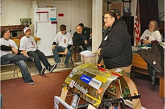 DAVID F. ASHTON - This 2010 photo shows mentor Rebecca LohKamp speaking in the basement lab in Southeast Portland where FIRST Robotics Team 1432 now meets - and where it develops its latest robot for regional competition each year, such as the one next to her. In the background are some members of the team, and other team mentors.