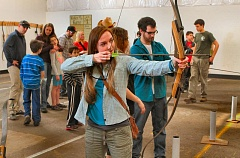 DAVID F. ASHTON - Inspired by Hunger Games character Katniss Everdeen, Montana State University student Kelsey Martin learns the basics of archery at Trackers, on S.E. Milwaukie Avenue, a half block south of Holgate Boulevard.