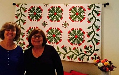 SUBMITTED PHOTO - Lori Friedman, left, and Joan Peck want to spread the joy of quilt history across Oregon. Here they pose, beside one of Pecks prized quilts.