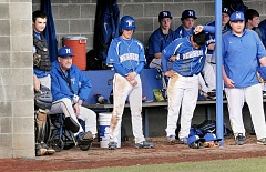 SETH GORDON - Dedicated to the game - Former Major League Baseball player Jeff Holly watches the action during Newberg's season-opening loss to South Salem last month. Holly lost his leg to complications from diabetes 18 months ago, but 'could lose both my legs and I'd still be coaching kids.'