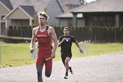 PHIL HAWKINS - Woodburn senior Nate Bosquez (right), pictured in the 4x100 relay, later took home first place in the 100-meter dash (11.74) at Wednesdays home track meet against Central.