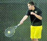GARY ALLEN --  - Ground stroke -- Israel Pintor hits a forehand during his loss to Tigard's Daniel Trahan April 1. Newberg won the overall match 7-1.