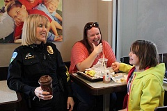 NEWS-TIMES PHOTO: DOUG BURKHARDT - Forest Grove Police Chief Janie Schutz chats with Forest Grove residents Jennifer Gustafson and her daughter, Sierra, during the Coffee with a Cop event at the Forest Grove McDonalds on April 1.