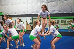 TIMES PHOTO: ADAM WICKHAM - Emma Cordova (top right) rehearses with cheer team Hazzard, which heads to Florida next month for its last, and biggest, competition.