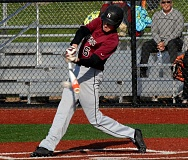 PAMPLIN MEDIA GROUP: PARKER LEE - ON TARGET -- Sherwood senior Rich Hekker gets his bat on the ball during the win at Sandy.