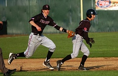 DAN BROOD - TAG, YOU'RE OUT -- Tualatin senior third baseman Nathan Senger (left) tags out Oregon City's Matt Weseman in a rundown during last week's game. Senger, playing in just his second game this season, had three hits and three RBIs in the Wolves' 9-1 victory.