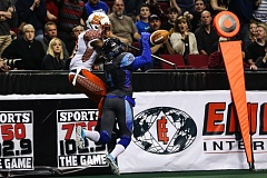 TRIBUNE PHOTO: DAVID BLAIR - Portland Thunder defensive back Osagie Odiase picks off a Spokane Shock pass with 20 seconds to go Thursday night, preserving an Arena Football League triumph for the home team at Moda Center.