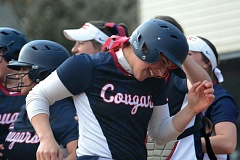 ESTACADA NEWS: DAVID BALL - Clackamas CCs Ashley Culp is greeted at home plate after hitting the winning home run in the fifth inning of last weeks South Region opener at Mt. Hood CC.