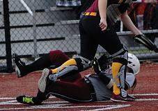 SANDY POST: PARKER LEE - Sandys Presley Turin crashes into home plate during the Pioneers season-opening win over Central Catholic.