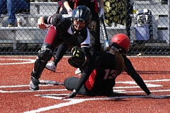 SANDY POST: PARKER LEE - Sandy catcher Mackenna Brisbane applies the tag in a play at home plate during the teams spring break loss to Union, Wash.