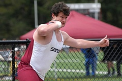 SANDY POST: PARKER LEE - Sandys Chris Salmela takes a spin in the shot put ring on his way to a win in the event.