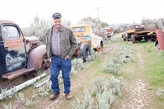 KEVIN SPERL - Bill Weberg walks across this property admiring his his collection of antique rigs.