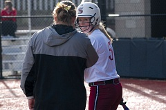 SANDY POST: PARKER LEE - Sandy coach Kelly Wilkerson brings a smile to Molly Nutts face on her way to the batters box during last weeks home win over Milwaukie.