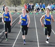 LON AUSTIN/CENTRAL OREGONIAN - Audrey Bernard, Madie Bernard and Laken Berlin race towards the finish line in the 100-meter dash at the Ridgeview Invitational. Madie Bernard narrowly won the race, while Berlin was third and Audrey Bernard came in fourth.