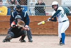 LON AUSTIN/CENTRAL OREGONIAN - Karlee Hollis rips a single during the Cowgirls 8-1 win over the Molalla Indians on Monday. Hollis was 3-4 in the game with a double.