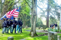 GARY ALLEN - In memoriam - Civil War enactors from the Sons of the Veterans Reserve present the colors during an event commemorating the 150th anniversary of the war's conclusion Saturday.
