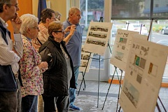 RAY HUGHEY - Canby residents look over three design concepts for a new library-civic building during one of two meetings last week.