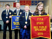 SETH GORDON - The next generation - Newberg High School freshmen (from left) Wayne Barnett, John McCarthy, Todd Halleman and Abby Bull show off the FFA state championship medals and banners they earned at the FFA State Convention in Silverton. Barnett, McCarthy and Halleman won titles for their agri-science experiments, while McCarthy placed first and Bull second in beginning public speaking.
