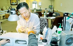 GARY ALLEN - Doing nails - Luxury Nails owner Kevin Hoang worked in nail salons around Oregon for 22 years before buying his own nail salon on North Springbrook Road. Originally from Vietnam, Hoang worked as a tailor prior to his move to the United States in the 1980s.