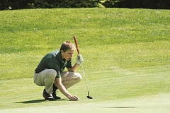 PHIL HAWKINS - Senior Derek Jones lines up his putt on the seventh green at Langdon Farms Golf Club on Thursday.