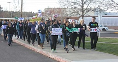 SUSAN MATHENY/MADARS PIONEER - Students and teachers marched to Tuesday night's school board meeting carrying signs and chanting 'Reinstate SBS,' in support of MHS Principal Sarah Braman-Smith.