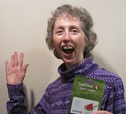 SUBMITTED PHOTO - Carrol Johnson picked the winning bracket of the recent March Madness NCAA National Basketball Championship. Her prize was a $25 gift card to Safeway.