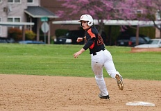JOHN WILLIAM HOWARD - Scappose sophomore Hunter Holmason rounds second base during the Indians' home win over Banks on April 7. Holmason's two-RBI single in the seventh inning of the game on April 15 put Scappoose ahead of Banks 3-2.