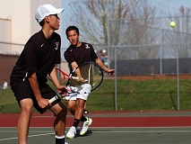 DAN BROOD - TEAMWORK -- Tualatin High School freshman Kien Nguyen (left) and senior Dahn Nguyen scored a win in No. 1 doubles play against Sherwood to stay unbeaten in Three Rivers League play this season.